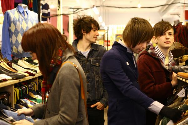 answering machine are not here, they're out shopping for clothes.
